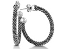 If you are searching for a pair of everyday hoops, with a hint of flair, then look no further.  These classic silver earrings are light and durable.  The earrings are 1 inch in diameter.
