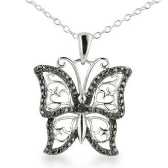 "If you ""heart"" butterflies, than this is the Necklace for you! This sterling silver Necklace features a black diamond accented butterfly, with sterling silver filigree heart detailing. Diamond content is .02 carats in black color and I3 clarity. The chain is 18 inches long."