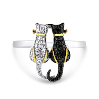 Cat jewelry is always in! Be sure to get this trendy two tone black diamond cat ring. Diamond content is .02 carats in black color and I3 clarity. This ring is crafted in solid sterling silver and is available in ring sizes 5-8.
