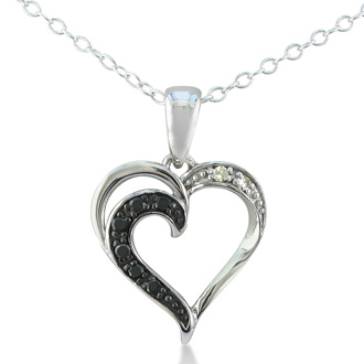 Let her know she's loved with this subtle and sweet black and white diamond heart pendant in sterling silver. Diamond Content is .08 carat in I/J color, I2 clarity.
