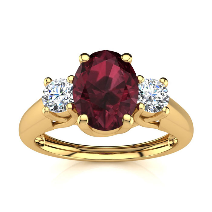 1 1/5 Carat Oval Shape Garnet And Two Diamond Ring In 14 Karat Yellow Gold