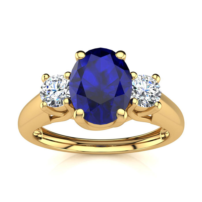 1 1/5 Carat Oval Shape Sapphire And Two Diamond Ring In 14 Karat Yellow Gold