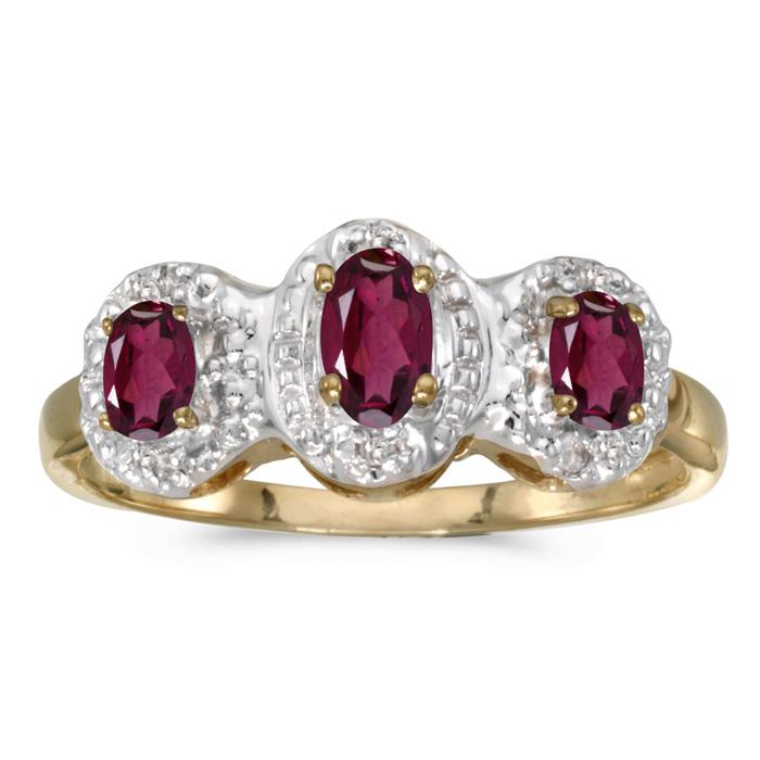 10k Yellow Gold Oval Rhodolite Garnet And Diamond Three Stone Ring