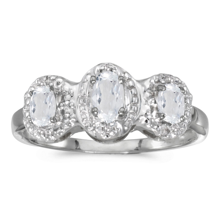 10k White Gold Oval White Topaz And Diamond Three Stone Ring