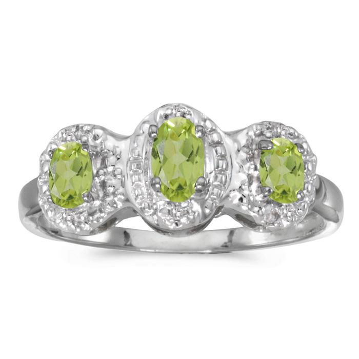 10k White Gold Oval Peridot And Diamond Three Stone Ring