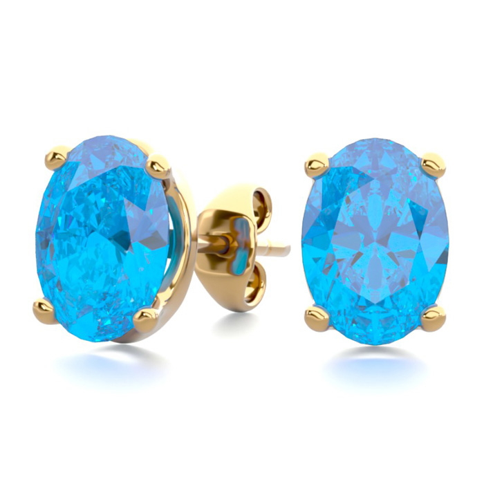 2 Carat Oval Shape Blue Topaz Stud Earrings In 14k Yellow Gold Over Sterling Silver
