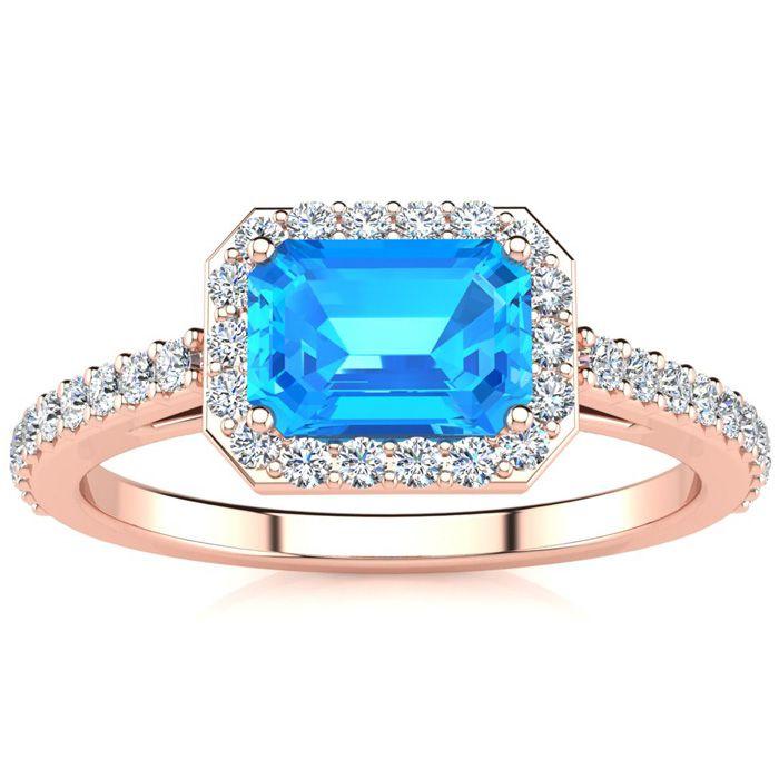 1 1/2 Carat Emerald Shape Blue Topaz And Halo Diamond Ring In 14 Karat Rose Gold