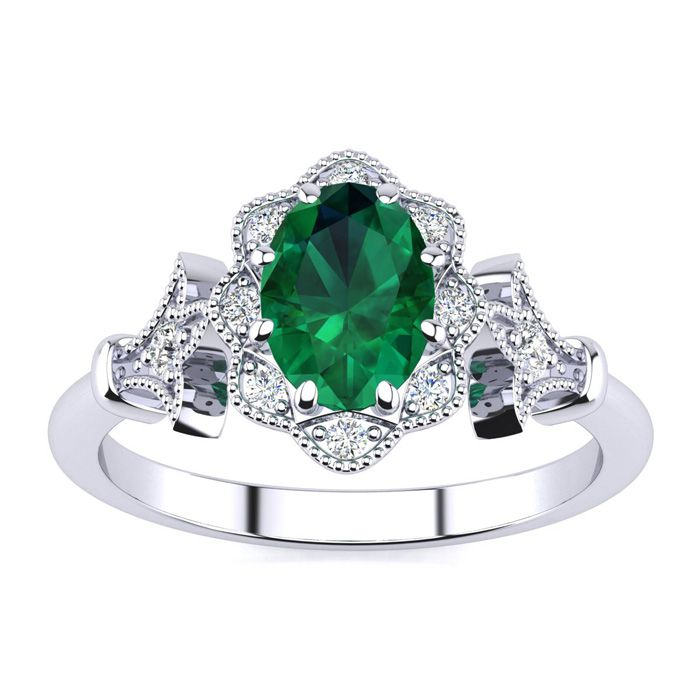 1 Carat Oval Shape Emerald And Halo Diamond Vintage Ring In 14 Karat White Gold