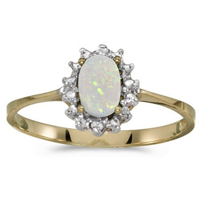 1/4ct Oval Opal And .04ct Diamond Ring In 10k Yellow Gold