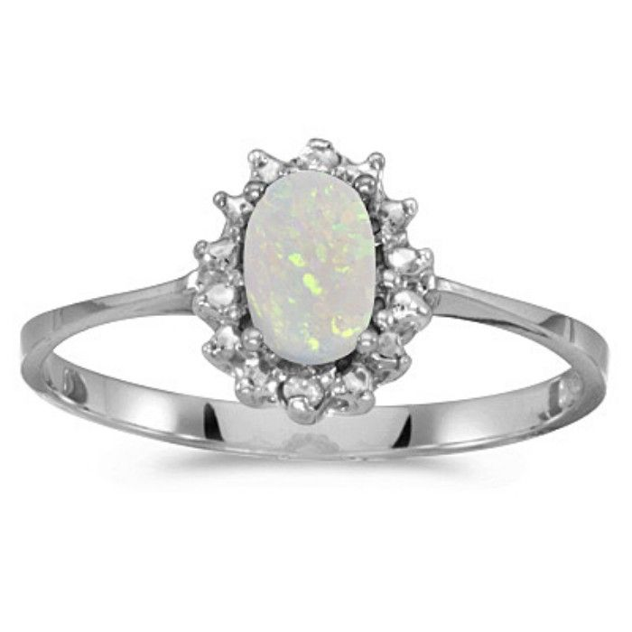 1/4ct Oval Opal And .04ct Diamond Ring In 10k White Gold