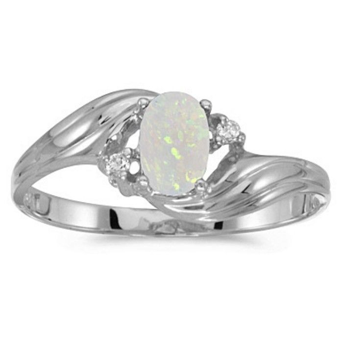 1/4ct Oval Opal And .02ct Diamond Ring In 10k White Gold